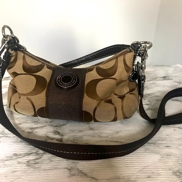 Coach tan canvas crossbody handbag